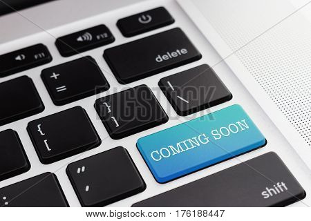 COMING SOON: Close up green button keyboard computer. Digital Business and Technology Concept.