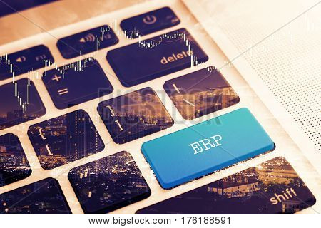 ERP (ENTERPRISE RESOURCE PLANNING): Close up green button keyboard computer. Vintage Effects. Digital Business and Technology Concept.