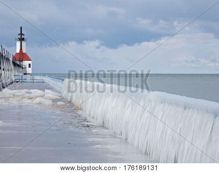 The newly refurbished St. Joseph Lighthouse stands at the end of the pier, where the St. Joseph River empties into Lake Michigan. The splash of water from the river has formed icicles on the railing and made walking treacherous, but the scene is beautiful