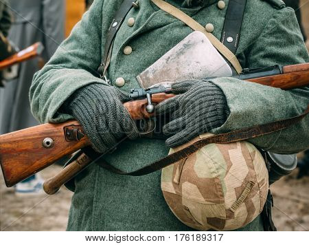 A rifle in the hands of sodat Wehrmacht. Elements of equipment of the German army close-up