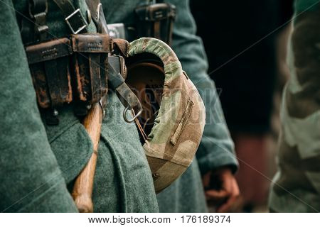Part of the equipment of a Wehrmacht soldier and a helmet on the soldier's belt