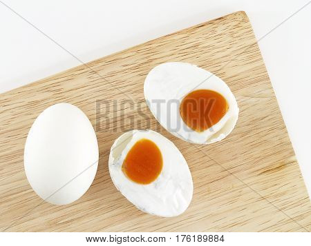 salted eggs on a wooden cutting board, food typical of Southeast Asia, top view
