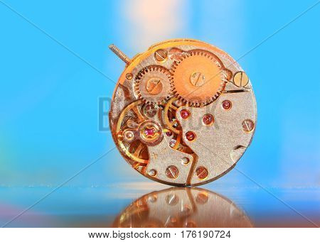 Extreme close up shot of watch mechanism with dramatic background