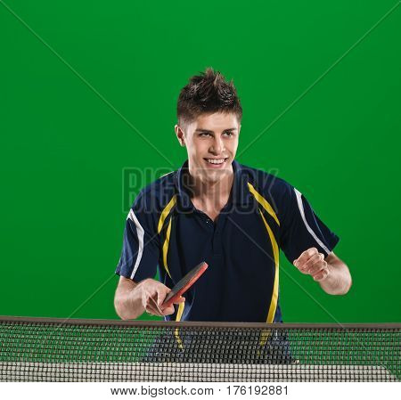 Happy smiling man playing ping pong green chromakey background