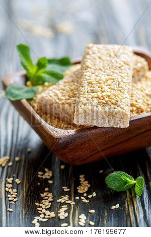 Bowl With Sesame Seeds And Honey Bars With Sesame Seeds.