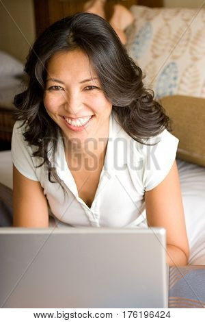 Beautiful woman laughing and working on the computer.