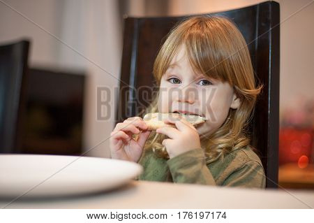 Little Child Biting Pizza Portion Looking