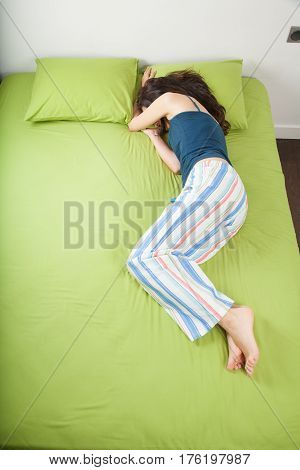 Woman Sleeping Hiding Face Under Arm