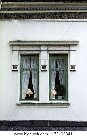 lampshade lit window exterior green  architecture illuminated