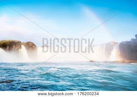 Magical view of powerful Godafoss cascade. Popular tourist attraction. Gorgeous scene. Location Bardardalur valley, Skjalfandafljot river Iceland Europe. Glowing filter. Discover the world of beauty