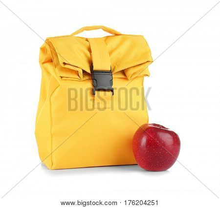 Healthy food concept. Lunch bag for school children and fresh apple on white background
