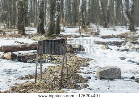 The brazier is in the forest. Place for barbecue