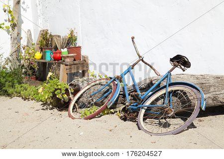 old blue bike, abandoned on the beach
