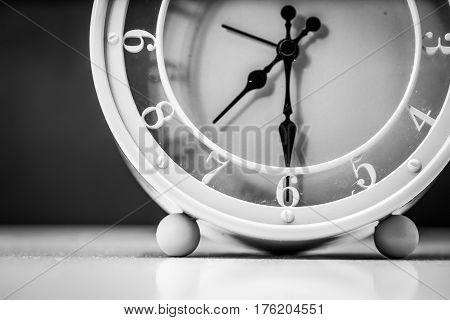 Table Clock Closeup On Black Background