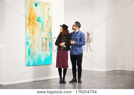 Young couple in modern art gallery
