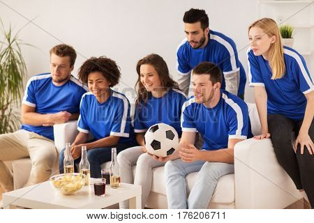 friendship, leisure, sport and entertainment concept - happy friends or football fans with drinks watching soccer at home