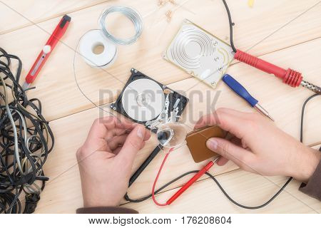 Fixing electrical components with wires soldering iron and instruments.