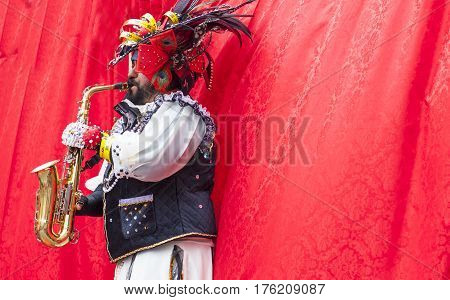 Badajoz Spain - February 28 2017: Saxophonist takes part in the Carnival parade of troupes. This is one of the best carnivals in Spain especially highlighting massive participation of people