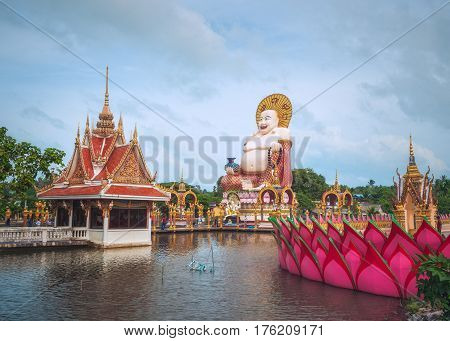 Koh Samui, Thailand - Januar 1st 2017: The Statue of Budai, the Chinese Style laughing Buddha, in Wat Plai Leam Buddhist Temple (Samui Floating Temple) built in Early 2000s.