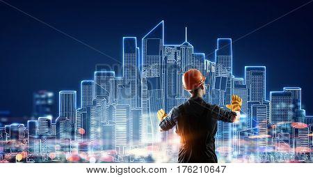 Builder man using media interface . Mixed media