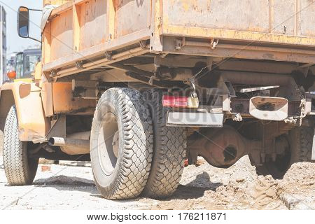 Truck on a construction site with sand dirt and cement.