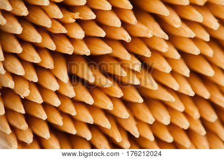 horizontal top view macro close up of wooden bamboo toothpicks pattern with selective focus