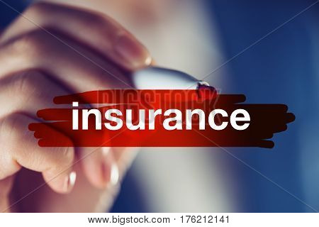 Business insurance concept businesswoman highlighting word with red marker pen