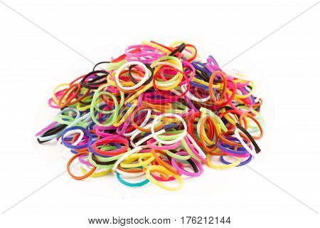 horizontal top view background of many multicolored rubber elastic bands