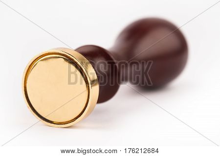 front view of personal stamp tool with wooden handle and metallic golden blank head isolated on white selective focus