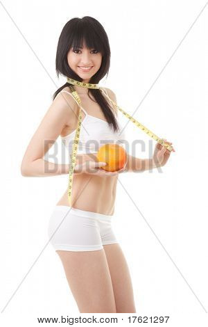 Cute woman with orange and measure tape