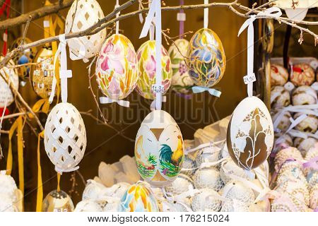 Vienna, Austria - April, 5, 2015:  Colorful painted yellow Easter eggs on the tree at the traditional European market