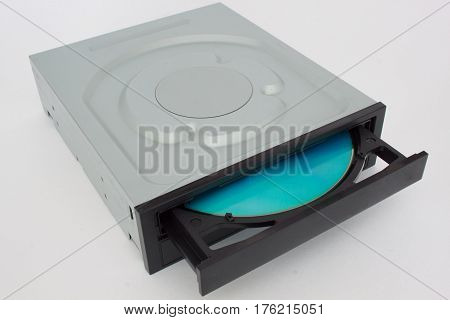 Opened CD - DVD drive with a black cap and blue disk. On the white background.