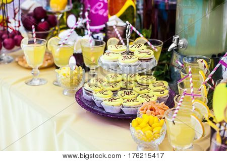 Delicious sweeties, fruits and beverages, staying on dessert table