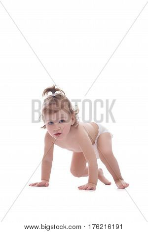 Baby girl. Cute young girl wearing a diaper crawling isolated on white copyspace family children kids infant adolescence cuteness love family parenting parenthood concept