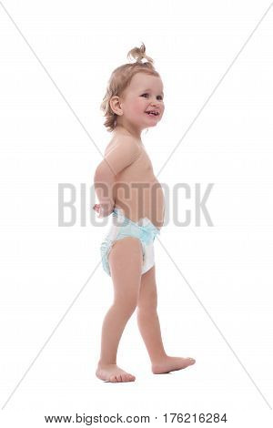 Walking around. Cute little baby girl wearing a diaper laughing happily while walking isolated on white copyspace family children child kid childhood infant family love cuteness concept