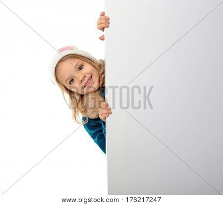 Cute little girl in warm clothes with poster on white background