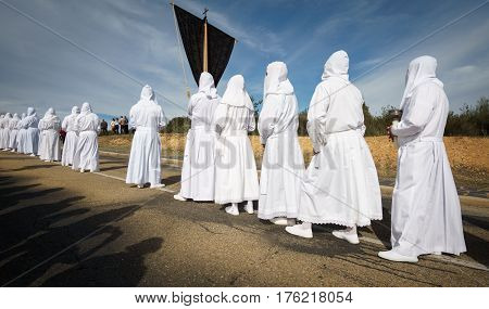 Tourist shadows enjoying easter traditional procession in bercianos de aliste brotherhood, zamora, Spain