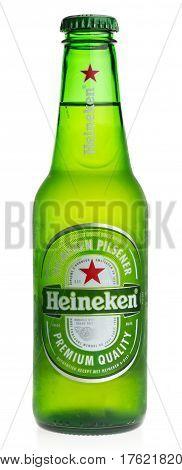 GRONINGEN, NETHERLANDS - MARCH 13, 2017: Bottle of Heineken Pilsener beer isolated on a white background