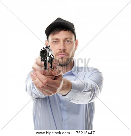 Security man going to shoot from gun, isolated on white