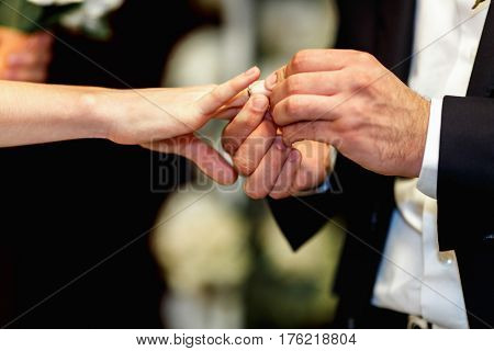 Fiance Puts A Wedding Ring On Delicate Bride's Hand