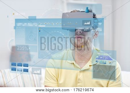 technology, augmented reality, big data and people concept - young man with virtual headset or 3d glasses looking at screens projection