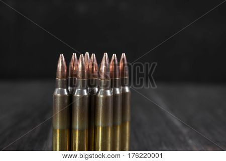 Group of  ammunition geometrically placed in rows