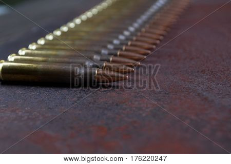 Group of  ammunition on a rusted metal background selective focus