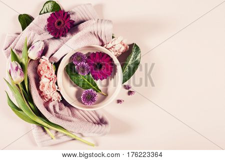 Spa background with flowers and towel. Flat lay.Space for text