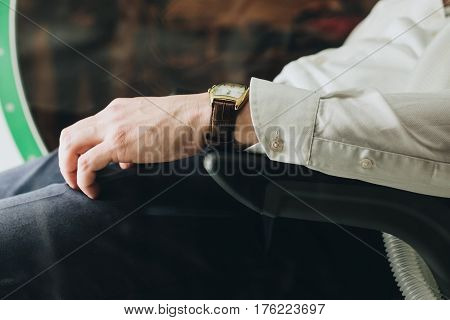 Hand On The Arm Of A Man Sitting In A Chair