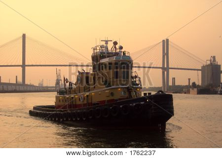 Tug On The River At Evening