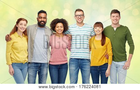 diversity, race, ethnicity and people concept - international group of happy smiling men and women over summer green lights background