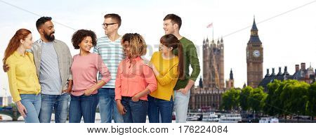 travel, tourism, diversity, ethnicity and people concept - international group of happy smiling men and women over london city background