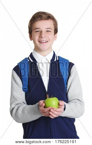 Cute schoolboy with apple on white background