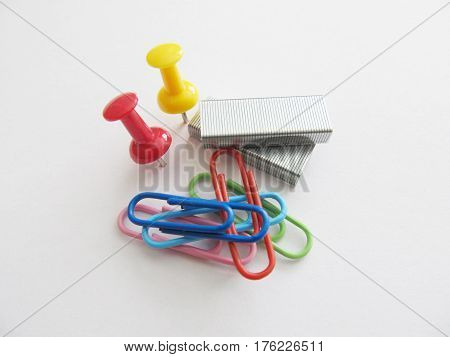 Set of stationery, clip, staples, buttons on isolated background